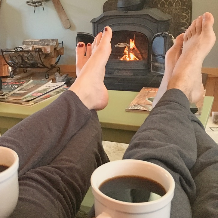 couple drinking coffee by the fire